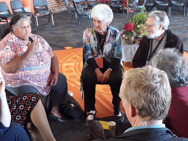 Facilitator Dale Hunter ( center ) at work, listening for collective intelligence.